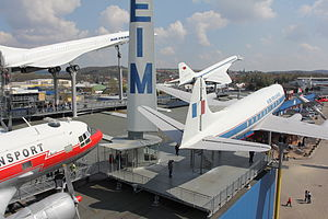 Auto & Technik Museum Sinsheim - Aircraft on the roof of the museum building.