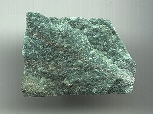 Aventurine - Aventurine is used for a number of applications, including landscape stone, building stone, aquaria, monuments, and jewelry. (Unknown scale)