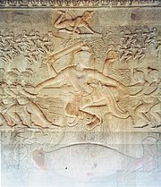 The bas-relief of the Churning of the Sea of Milk shows Vishnu in the centre, his turtle avatar Kurma below, asuras and devas to left and right, and apsaras and Indra above, from Ankor Wat
