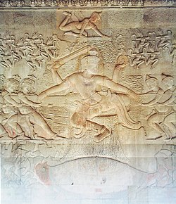 The bas-relief of the Churning of the Sea of Milk shows Vishnu in the centre, his turtle avatar Kurma below, asuras and devas to left and right, and apsaras and Indra above.