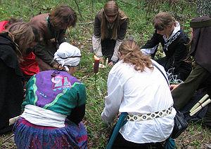 Eight magicians doing a ritual at a live actio...