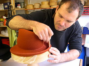 Hatmaking - Hat-maker making a felt hat