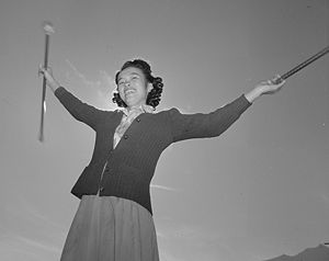Baton twirling - Baton practice, Manzanar War Relocation Center, 1943. Photographed by Ansel Adams.