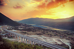 Transport in Kosovo - Scenic view of Albania–Kosovo Highway with White Drin river flowing nearby.