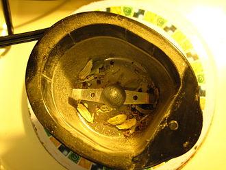 Blade grinder - Blade grinder used to separate cardamom seeds from pods