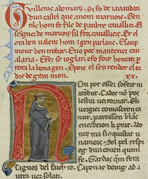 Guilhem Ademar - Guillem as a monk. The text of his vida is in red above him (BnF ms. 854).