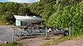 Boat trailers and sailboat in Rixö Marina.jpg