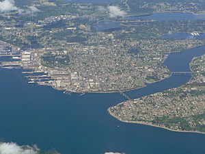 Bremerton, Washington - Sinclair Inlet and Puget Sound Naval Shipyard (left), Dyes Inlet (middle distance) and Manette and Warren Avenue Bridges (left to right) across Port Washington Narrows