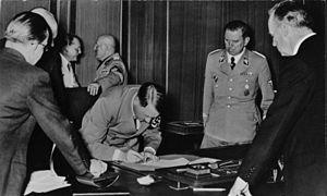 Julius Schaub - Schaub (on Hitler's left) at the signing of the Munich Agreement, 1938