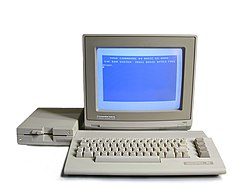 A Commodore 64c system, showing the basic layout of a typical home computer system of the era. Pictured are the CPU/keyboard unit, floppy disk drive, and dedicated color monitor. Many systems also had a printer for producing paper output.