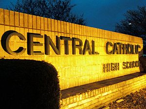 Central Catholic High School (Perry Township, Ohio) - Central Catholic's sign on The Great Front Lawn shines in the night.
