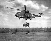 CH-3C lifts jeep during Gold Fire I 1964