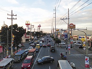 Las Piñas - Alabang-Zapote Road (N411) in 2011. The road continually suffers from perennial traffic congestion resulting from increasing traffic.