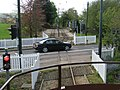 Car crosses the tramway level crossing at Colyford - geograph.org.uk - 1285286.jpg