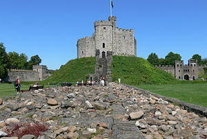 Cardiff Castle - Part of the reconstructed Roman wall (l), the foundations of the internal bailey wall, and the reconstructed Roman north gatehouse (r)