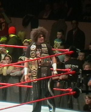 The Colóns (2002–2010) - Carlito holding the Unified WWE Tag Team Championship