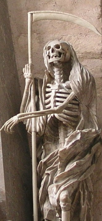 Death (personification) - Statue of Death, personified as a human skeleton dressed in a shroud and clutching a scythe, from the Cathedral of Trier in Trier, Germany