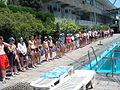 Child swimmers in a line at a swim meet.jpg