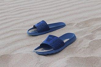 Slide (footwear) - A pair of sliders