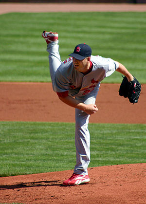 Chris Carpenter completes a pitch for the St. ...
