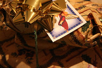 Christmas present wrapped with a gold bow and ...