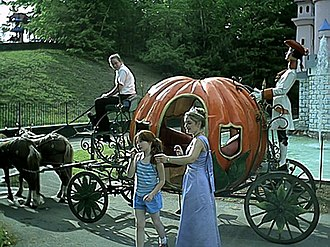 Six Flags Great Escape Theme Park & Lodge - A girl and Cinderella getting out of her pumpkin coach.