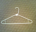 Coat hanger on the floor.png