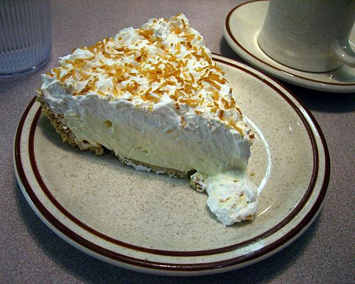 Photo of a slice of coconut cream pie. Taken at the Golden Nugget Restaurant, Chicago, Ill.