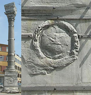 Column of Marcian - One of the faded IX monograms inside a wreath at the base of the column.