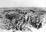Soldiers in a ruined trench system the landscape is devoid of any flora or fauna