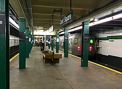 "The underground Court Square station is the ""G"" train's northern terminus. There are two tracks in the station, one on each side of the center platform, with a ""G"" train on the right-hand track."