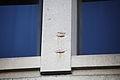 Damaged column and netting around moulding - east facade - J Edgar Hoover Building - Washington DC - 2012.jpg