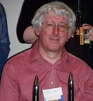 David Langford - David Langford at Worldcon 2005 in Glasgow, with two Hugo Awards.