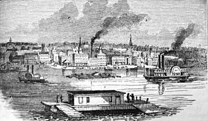 Davenport, Iowa - Picture of Davenport in 1865; on the right is the Steamboat Iowa, which appears in the Seal of Iowa.