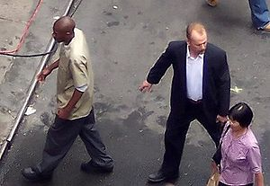 Mos Def - Mos Def and Bruce Willis on the set of 16 Blocks, filmed on location in Chinatown, Manhattan on Pell Street