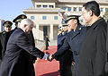 Defense.gov News Photo 110110-F-6655M-012 - Secretary of Defense Robert M. Gates is greeted by the staff of Chinese Minister of Defense Liang Guanglie as he arrives at the Bayi building in.jpg