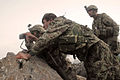 Defense.gov News Photo 110626-A-RR514-128 - U.S. Army soldiers with Delta Company 2nd Battalion 35th Infantry Regiment and an Afghan National Army soldier 2nd from right search a valley for.jpg