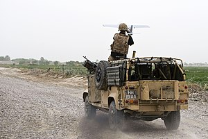 Unmanned systems of the British Army - A Desert Hawk being launched from a WMIK Land Rover.