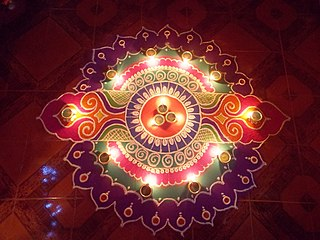 Traditional art form of India, in which coloured patterns are created on the ground
