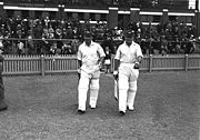 Bradman (left, with his vice-captain Stan McCabe) walks out to bat at Perth, during a preliminary match to the 1938 tour of England. Bradman scored 102.