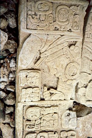 Seibal - Part of relief at the base of Dos Pilas Stela 16 showing both the Seibal emblem glyph and the face of Yich'aak B'alam
