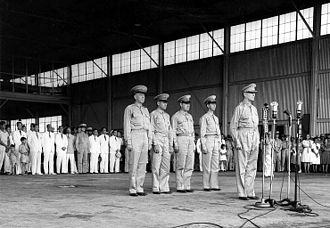 United States Army Forces in the Far East - Lt. Gen. Douglas MacArthur conducts a ceremony formally inducting the Philippine Army Air Corps into United States Army Forces in the Far East at Camp Murphy, Rizal on 15 August 1941. Behind MacArthur, from left to right, are: Lt. Col. Richard K. Sutherland, Col. Harold H. George, Lt. Col William F. Marquat, and Maj. LeGrande A. Diller.