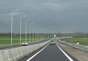 Roads in the Netherlands - Single carriageway expressway economically upgraded to meet most of the new regional flow road standard. A physical traffic barrier, and a hard shoulder were added.