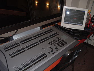 Lighting control console - An Express series memory console by Electronic Theatre Controls capable of controlling both normal stage lighting instruments as well as intelligent lighting.