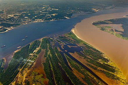 The confluence of the Rio Negro (black) and the Rio Solimoes (turbid) near Manaus, Brazil. Encontro das Aguas - Manaus.jpg