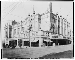 Exterior view at the corner of Seventh Avenue and Olive Way, looking NE. Opening night film, 'The Broadway Melody,' displayed on the canopy marquee. - Fox Theater, Seventh HABS WASH,17-SEAT,11-46.tif