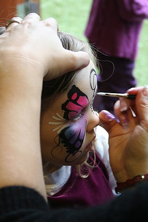 Child receiving the final touches of facepaint...