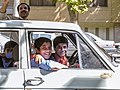 Family in automobile wants to photograph an American in Isfahan, Iran (14288446498).jpg
