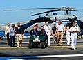 Flickr - Official U.S. Navy Imagery - Former Presidents George H.W. Bush, center, and George W. Bush, left, make their way across the flight deck of USS George H.W. Bush..jpg