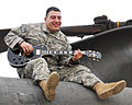 Flickr - The U.S. Army - Guard Soldier trades guitar for gun.jpg